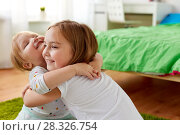 Купить «happy little girls or sisters hugging at home», фото № 28326754, снято 15 октября 2017 г. (c) Syda Productions / Фотобанк Лори