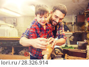 Купить «father and son with plane shaving wood at workshop», фото № 28326914, снято 14 мая 2016 г. (c) Syda Productions / Фотобанк Лори