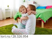 Купить «happy little girls or sisters hugging at home», фото № 28326954, снято 15 октября 2017 г. (c) Syda Productions / Фотобанк Лори