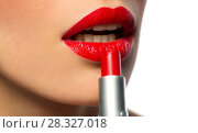 Купить «close up of woman applying red lipstick to lips», фото № 28327018, снято 5 января 2018 г. (c) Syda Productions / Фотобанк Лори