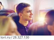Купить «happy young man travelling by plane», фото № 28327130, снято 21 октября 2015 г. (c) Syda Productions / Фотобанк Лори