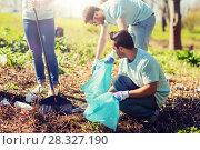Купить «volunteers with garbage bags cleaning park area», фото № 28327190, снято 7 мая 2016 г. (c) Syda Productions / Фотобанк Лори