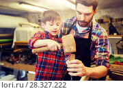 Купить «father and son with chisel working at workshop», фото № 28327222, снято 14 мая 2016 г. (c) Syda Productions / Фотобанк Лори