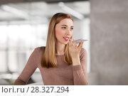 Купить «woman using voice recorder on smartphone at office», фото № 28327294, снято 25 февраля 2018 г. (c) Syda Productions / Фотобанк Лори