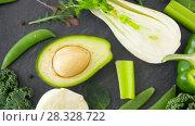 Купить «close up of green vegetables on stone table», видеоролик № 28328722, снято 14 апреля 2018 г. (c) Syda Productions / Фотобанк Лори