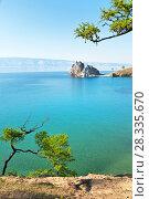 Купить «Summer landscape of Lake Baikal. Olkhon Island and Shamanka Rock is a natural landmark and a favorite place for visiting tourists», фото № 28335670, снято 13 июня 2010 г. (c) Виктория Катьянова / Фотобанк Лори