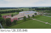 Купить «Castle park Rundale in Latvia drone flight above trees, summer time», видеоролик № 28335846, снято 24 апреля 2018 г. (c) Aleksejs Bergmanis / Фотобанк Лори