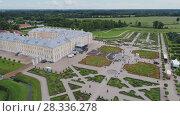 Купить «Castle park Rundale in Latvia drone flight above trees, summer time», видеоролик № 28336278, снято 24 апреля 2018 г. (c) Aleksejs Bergmanis / Фотобанк Лори