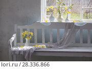 Купить «yellow spring flowers in white vintage interior», фото № 28336866, снято 22 апреля 2018 г. (c) Майя Крученкова / Фотобанк Лори