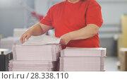 Купить «Female worker typography turning pages of a printed magazine», фото № 28338110, снято 22 июля 2018 г. (c) Константин Шишкин / Фотобанк Лори