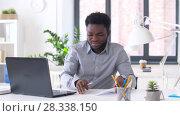 Купить «businessman with laptop and papers at office», видеоролик № 28338150, снято 19 апреля 2018 г. (c) Syda Productions / Фотобанк Лори