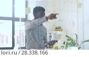Купить «businessman with tablet pc at office glass wall», видеоролик № 28338166, снято 19 апреля 2018 г. (c) Syda Productions / Фотобанк Лори