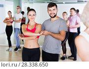 Купить «Group of young adults dancing salsa in club», фото № 28338650, снято 9 октября 2017 г. (c) Яков Филимонов / Фотобанк Лори