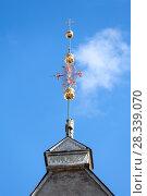 Купить «Позолоченный флюгер на шпиле Таллинской ратуши, Таллин, Эстония», фото № 28339070, снято 29 марта 2018 г. (c) Кекяляйнен Андрей / Фотобанк Лори