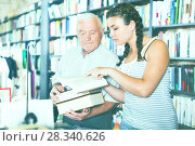 Купить «Grandpa with granddaughter are reading books», фото № 28340626, снято 28 июня 2017 г. (c) Яков Филимонов / Фотобанк Лори