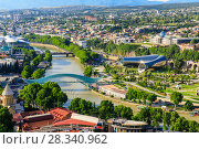Купить «Panoramic view of Tbilisi city from the Narikala Fortress, old town and modern architecture. Tbilisi the capital of Georgia», фото № 28340962, снято 17 октября 2018 г. (c) Mikhail Starodubov / Фотобанк Лори