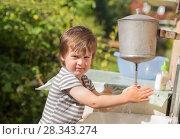 Купить «Cute boy washes his hands under washstand», фото № 28343274, снято 9 августа 2017 г. (c) Юлия Бабкина / Фотобанк Лори
