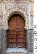 Купить «Traditional entrance gate with door in Fes», фото № 28343470, снято 16 февраля 2018 г. (c) Михаил Коханчиков / Фотобанк Лори