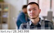 Купить «asian man with tattoo and ear tunnel at office», видеоролик № 28343998, снято 12 апреля 2018 г. (c) Syda Productions / Фотобанк Лори
