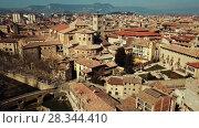 Купить «Aerial view of historic centre of Spanish town of Vic, Catalonia», видеоролик № 28344410, снято 6 марта 2018 г. (c) Яков Филимонов / Фотобанк Лори