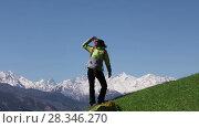 Купить «Backpacker climbs the mountains against the blue sky and snowy peaks of the majestic mountains of North Ossetia, Russia», видеоролик № 28346270, снято 27 апреля 2018 г. (c) Алексей Кузнецов / Фотобанк Лори