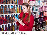 Купить «Female buying hair dye», фото № 28347682, снято 22 марта 2018 г. (c) Яков Филимонов / Фотобанк Лори
