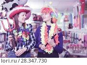 Купить «Girls in store of festival accessories», фото № 28347730, снято 15 марта 2018 г. (c) Яков Филимонов / Фотобанк Лори