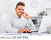 Купить «Business partner with smart phone and laptop», фото № 28347894, снято 14 декабря 2019 г. (c) Яков Филимонов / Фотобанк Лори