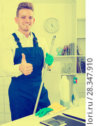 Купить «Man doing professional clean-up», фото № 28347910, снято 25 мая 2019 г. (c) Яков Филимонов / Фотобанк Лори