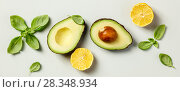 Купить «Avocado, lemon and basil», фото № 28348934, снято 5 апреля 2018 г. (c) Наталия Кленова / Фотобанк Лори
