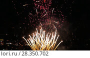 Купить «Fireworks flashing in the evening», видеоролик № 28350702, снято 28 апреля 2018 г. (c) Игорь Жоров / Фотобанк Лори