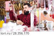 Купить «guy deciding on best sausage», фото № 28356170, снято 16 ноября 2016 г. (c) Яков Филимонов / Фотобанк Лори