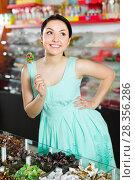 funny sexy female posing in the store with lolly. Стоковое фото, фотограф Яков Филимонов / Фотобанк Лори