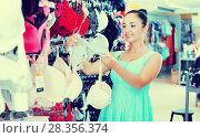Купить «Girl selecting underwear», фото № 28356374, снято 19 июня 2017 г. (c) Яков Филимонов / Фотобанк Лори