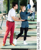Купить «Golf trainer teaches a woman game», фото № 28356590, снято 21 марта 2019 г. (c) Яков Филимонов / Фотобанк Лори