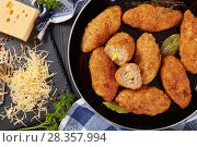 Купить «fried breaded juicy meat croquettes, close-up», фото № 28357994, снято 21 апреля 2018 г. (c) Oksana Zh / Фотобанк Лори