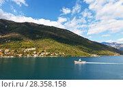 Купить «Montenegro. Top view on the coast of Boka Kotor Bay, the town of Kamenari and passenger ferry on a sunny day», фото № 28358158, снято 8 октября 2016 г. (c) Виктория Катьянова / Фотобанк Лори