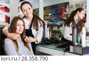 Купить «Young female hairdresser with male visitor in beauty salon», фото № 28358790, снято 31 марта 2018 г. (c) Яков Филимонов / Фотобанк Лори
