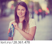 Купить «Woman quenching thirst with water», фото № 28361478, снято 15 августа 2017 г. (c) Яков Филимонов / Фотобанк Лори