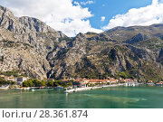 Купить «Montenegro. View from the water on the embankment and the sea mooring of the town of Kotor and the Old Town Road to the Fort of St. Ivan on the mountain», фото № 28361874, снято 8 октября 2016 г. (c) Виктория Катьянова / Фотобанк Лори