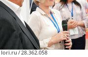 Купить «Female speaker at business conference speaks into the microphone», видеоролик № 28362058, снято 5 апреля 2020 г. (c) Константин Шишкин / Фотобанк Лори