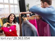 Купить «couple choosing clothes at vintage clothing store», фото № 28363054, снято 30 ноября 2017 г. (c) Syda Productions / Фотобанк Лори