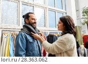 Купить «couple choosing clothes at vintage clothing store», фото № 28363062, снято 30 ноября 2017 г. (c) Syda Productions / Фотобанк Лори
