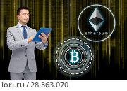 Купить «businessman with tablet pc and cryptocurrency», фото № 28363070, снято 29 января 2015 г. (c) Syda Productions / Фотобанк Лори