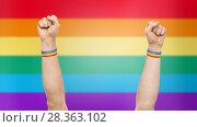Купить «hands with gay pride rainbow wristbands shows fist», фото № 28363102, снято 2 ноября 2017 г. (c) Syda Productions / Фотобанк Лори