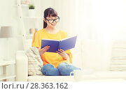 Купить «smiling young asian woman reading book at home», фото № 28363162, снято 9 марта 2016 г. (c) Syda Productions / Фотобанк Лори