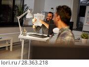 Купить «creative man showing papers to colleague at office», фото № 28363218, снято 24 января 2018 г. (c) Syda Productions / Фотобанк Лори