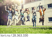 Купить «happy teenage students or friends jumping outdoors», фото № 28363330, снято 21 мая 2016 г. (c) Syda Productions / Фотобанк Лори