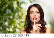 Купить «woman with red lipstick holding finger on mouth», фото № 28363418, снято 5 января 2018 г. (c) Syda Productions / Фотобанк Лори