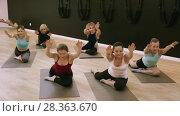 Купить «Smiling young women training yoga positions in modern yoga studio», видеоролик № 28363670, снято 14 февраля 2018 г. (c) Яков Филимонов / Фотобанк Лори